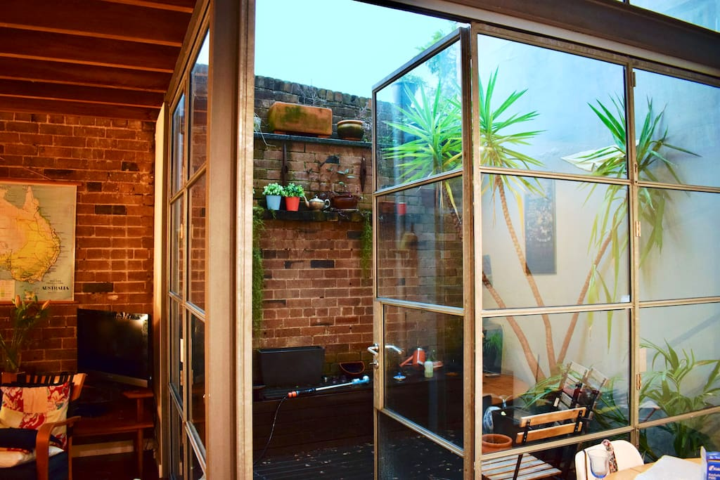 Outdoor courtyard ... extends the open plan living space, by opening both sets of bifold doors