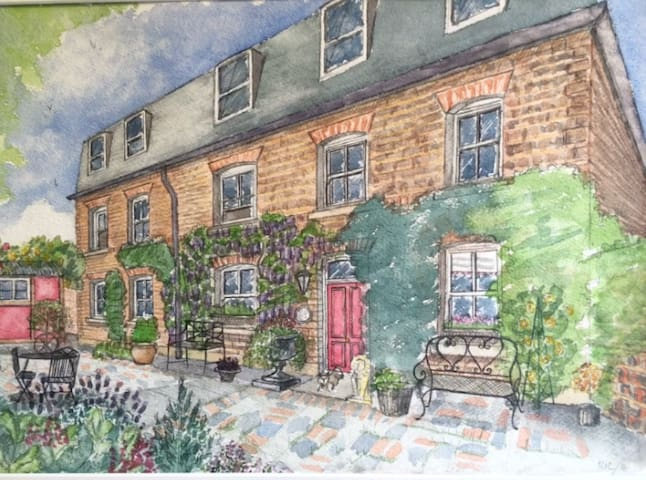 Beautiful painting of the cottage exterior.