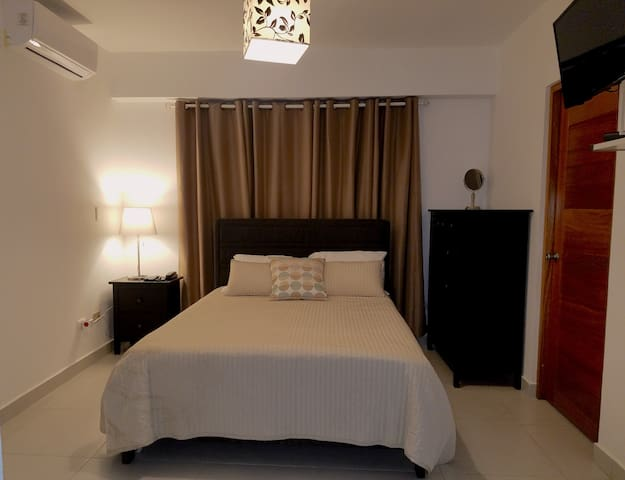 Welcoming bedroom with A/C, Flat TV with 150+ channels, WiFi and PHONE with local calling services.
