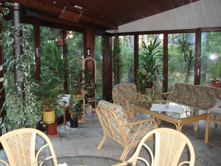Ferienhaus  mit Klimaanlage und 25qm Wintergarten.