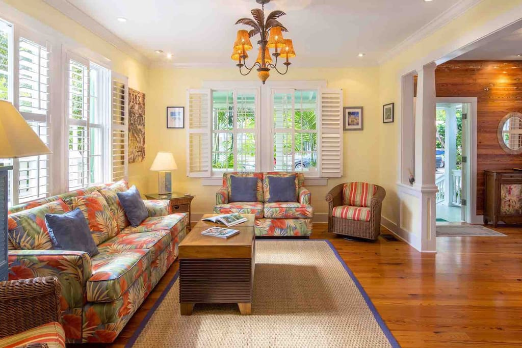 The living room is elegantly furnished with a tropical flair…