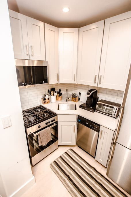 Stainless steel Blomberg fridge, full-sized dishwasher & oven with gas range & microwave. Toaster oven, Fully stocked Keurig Coffee Maker, and all silverware, cookware, & drinkware you may need.
