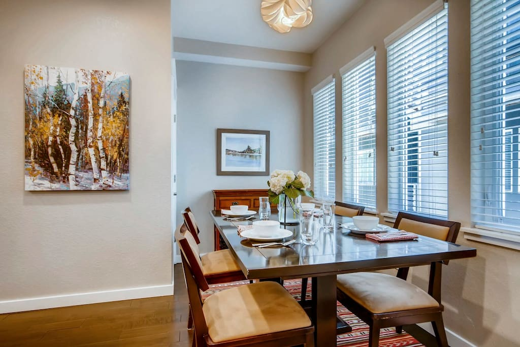 The dining room table and the counter top bar each provide seating for four, making it a great place to entertain.