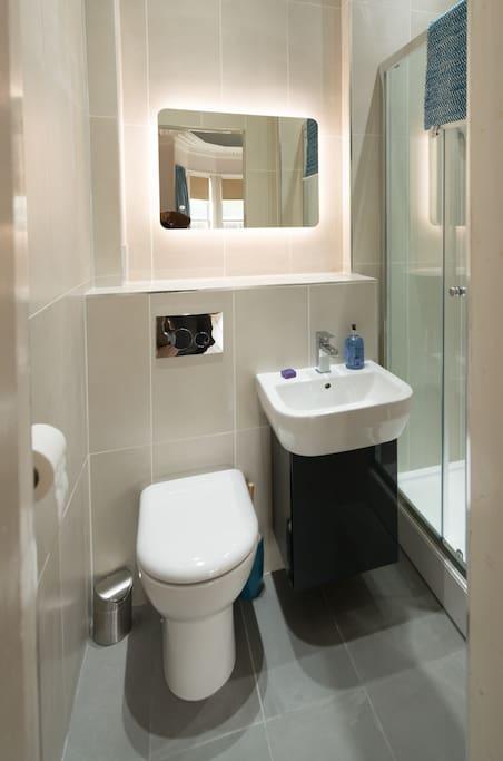 En-suite bathroom: recently refurbished