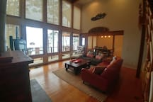 Living room with view of lake (boathouse in distance)