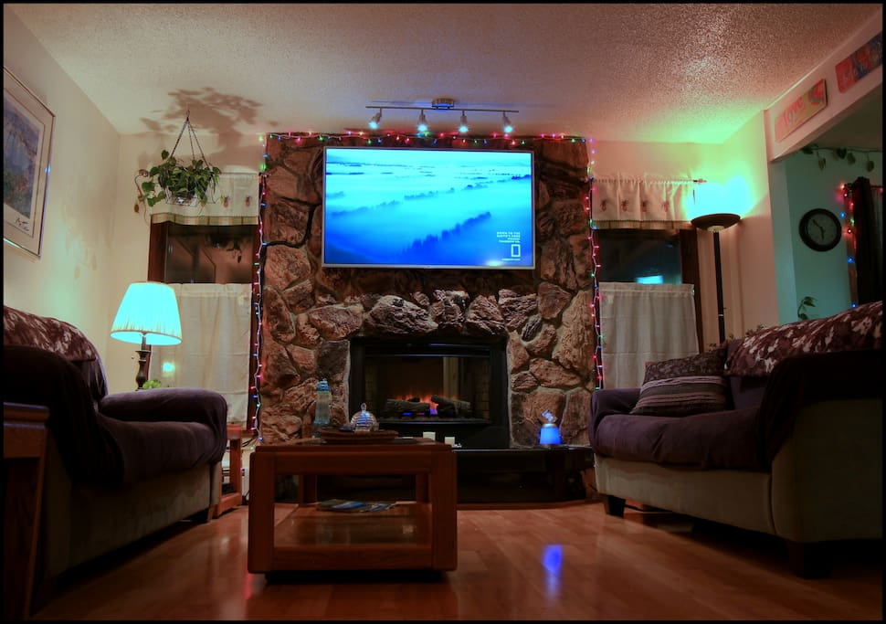 Comfortable couches and great living room setting with beautiful fire place