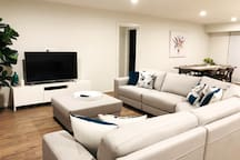 The living room is comfortable and well appointed with large flat screen TV and BluRay player