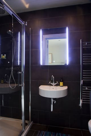 All of the ensuite bathrooms have been newly renovated and feature rain showers, contemporary lighting and handmade bath products.