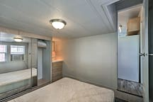 The private bedroom offers a queen-sized mattress!
