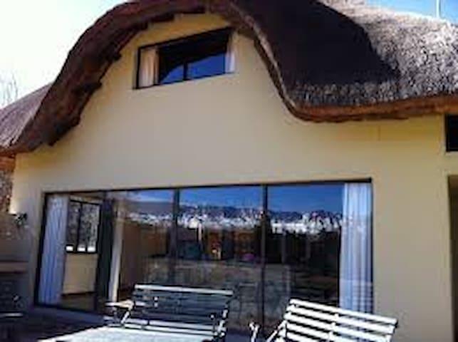 Castleburn resort 6-sleeper thatched chalet