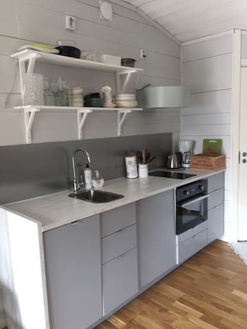Fully equipped kitchen with dishwasher, coffeemachine, fridge, oven/microwave and everything you need to cook a meal.