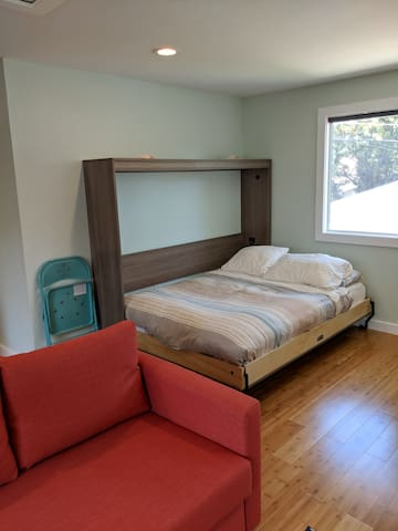 Queen size Murphy bed, with full size bed in couch.