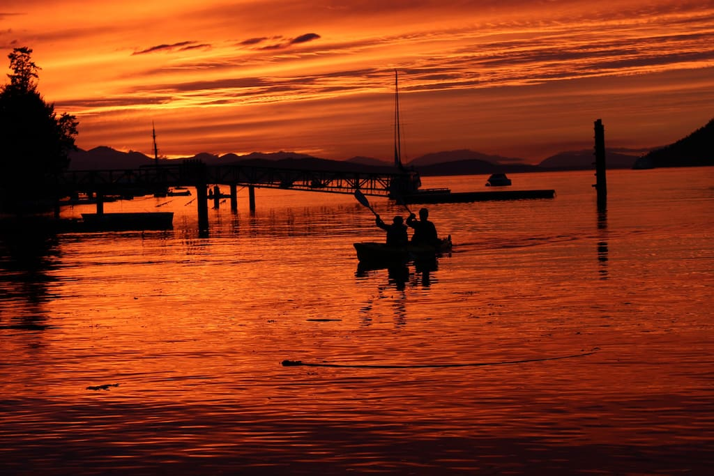 The colours of the sunset are different every evening, but these lucky kayaking guests saw orca whales jumping in this beauty of a sunset.