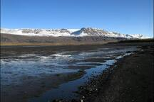 Short walk to a black sand beach with a nice view of the mountains
