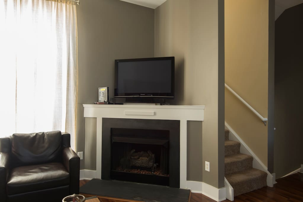 Relax and enjoy cable TV by the fireplace