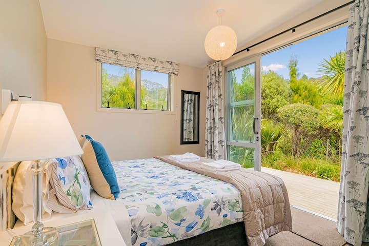 Bedroom 2 opens out onto deck - bed can be split into 2 singles
