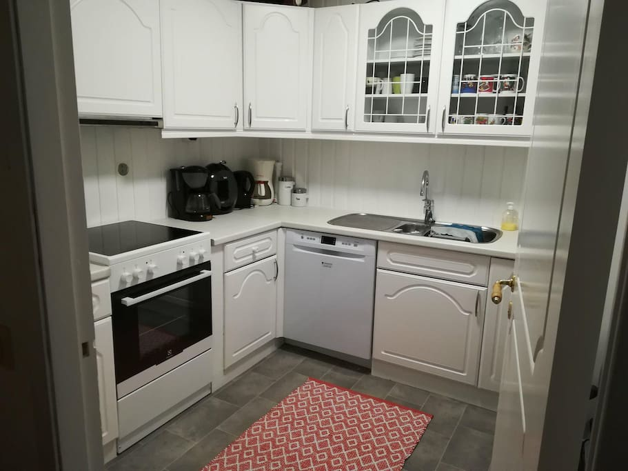A kitchen shared between the two rooms