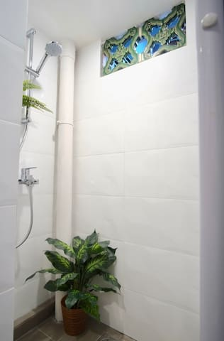 The two showers and three toilets are shared by the guests.