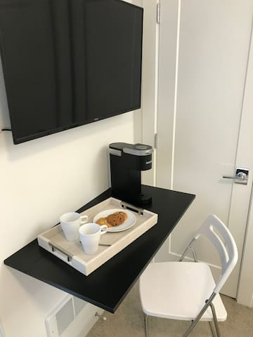 Work or hangout space in the room. A coffee maker is available for your personal use.