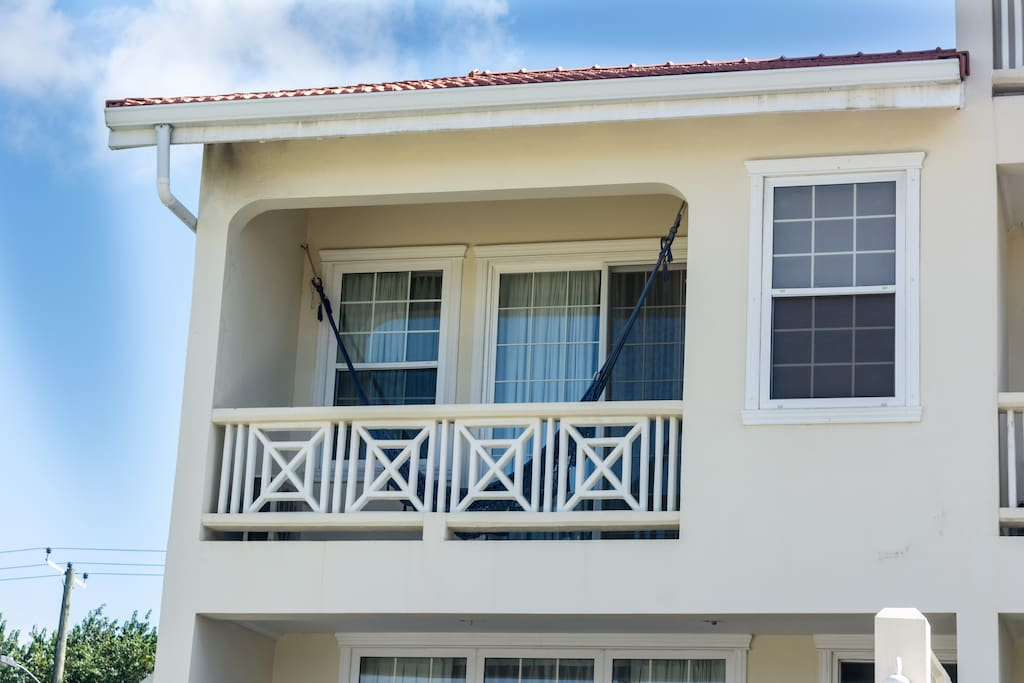 Front of apartment, with hammock in top floor balcony.