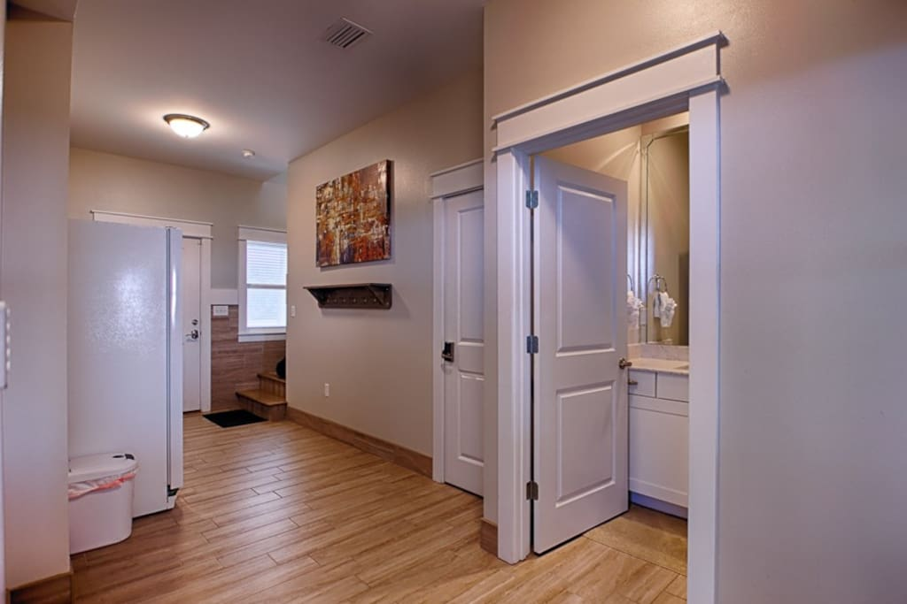 As you enter the home there will be the additional refrigerator and half bathroom down the hall.