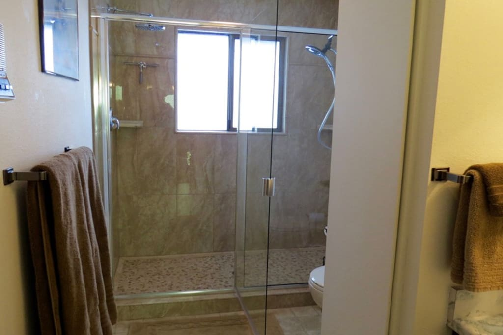 Tamarack's bathroom is across the hall.  It includes a walk-in shower with two rain-shower heads and a heated floor!