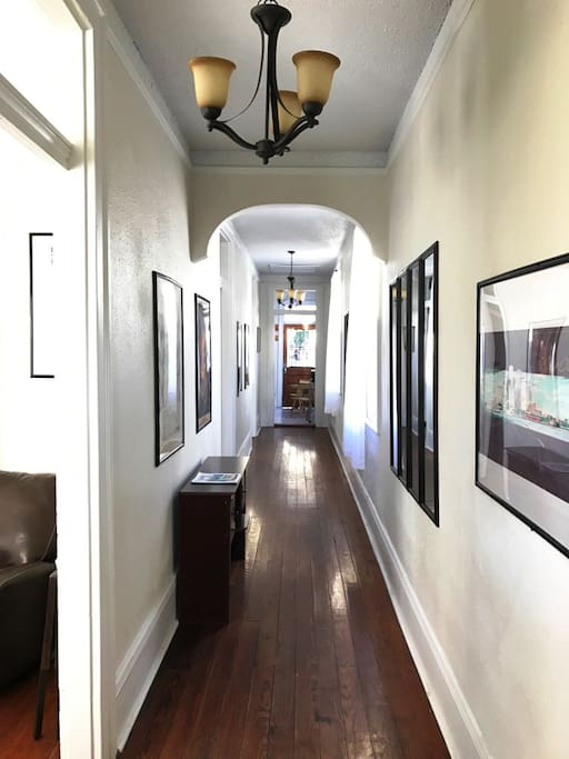 beautiful foyer/ entrance hall - filled with original New Orleans artwork!