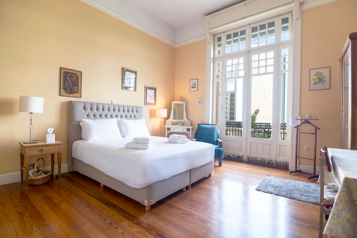 The bright master bedroom has a large double bed and access to the balcony.