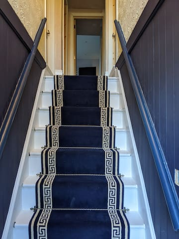 Hallway, the stairs are steep, if you book the downstairs bedroom you will have a bathroom downstairs also.