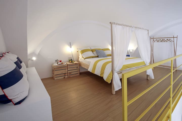 - The second colorful design bedroom on the yellow mezzanine with wood parquet paviment *Castle Maior* managed by #starhost #uniquehomesperfectstay #starhoststay