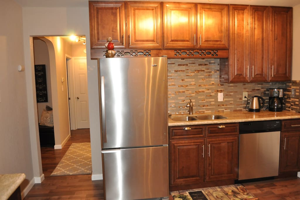 Gourmet Kitchen, fully stocked with high end Stainless Steel Appliances and a breakfast area