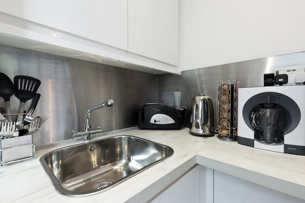 Kitchenette with coffee machine, toaster, kettle, microwave, hob and all crockery/cutlery