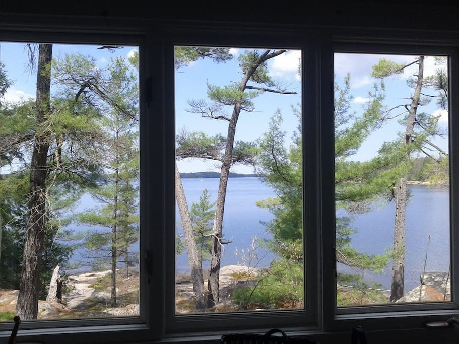 West view of lake, rocky shores, pine trees from east bedroom.