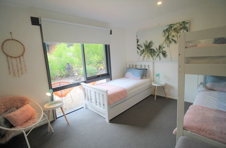 Third bedroom with Bunk beds & a Single bed with a trundle to sleep 4
