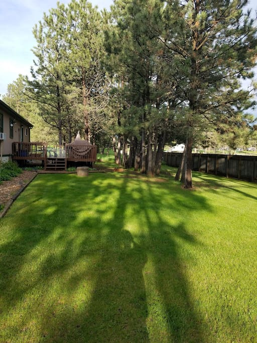 backyard with deck, bbq, horseshoes, and outside firepit