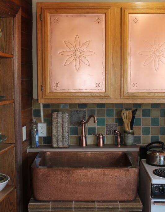 Close-up of copper farm house sink