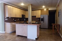 Fantastic kitchen complete with granite counter tops, glass top stove, huge refrigerator, and center island that is perfect for serving guests or extra work space!!