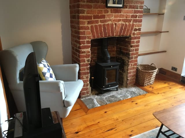 Cosy living room with log burner