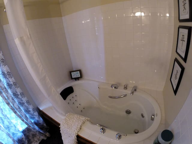 Large tub for a great soak.  Includes personal shower and optional jets.