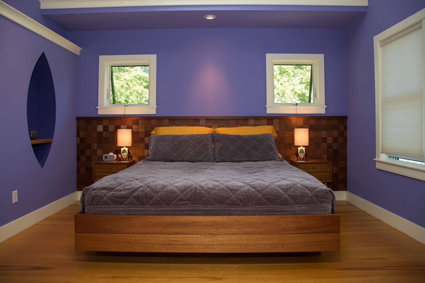 Custom-made reclaimed mahogany king-size bed & headboard with luxurious bamboo sheets. Cathedral ceiling with skylight.