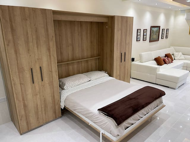 Comfortable Murphy bed comes down from the fitted unit effortless with ready made bed.