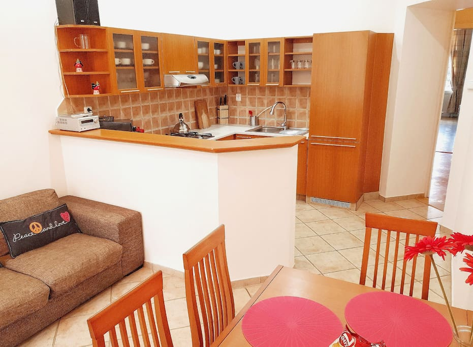 KITCHEN completely equipped with a dining area and sofa