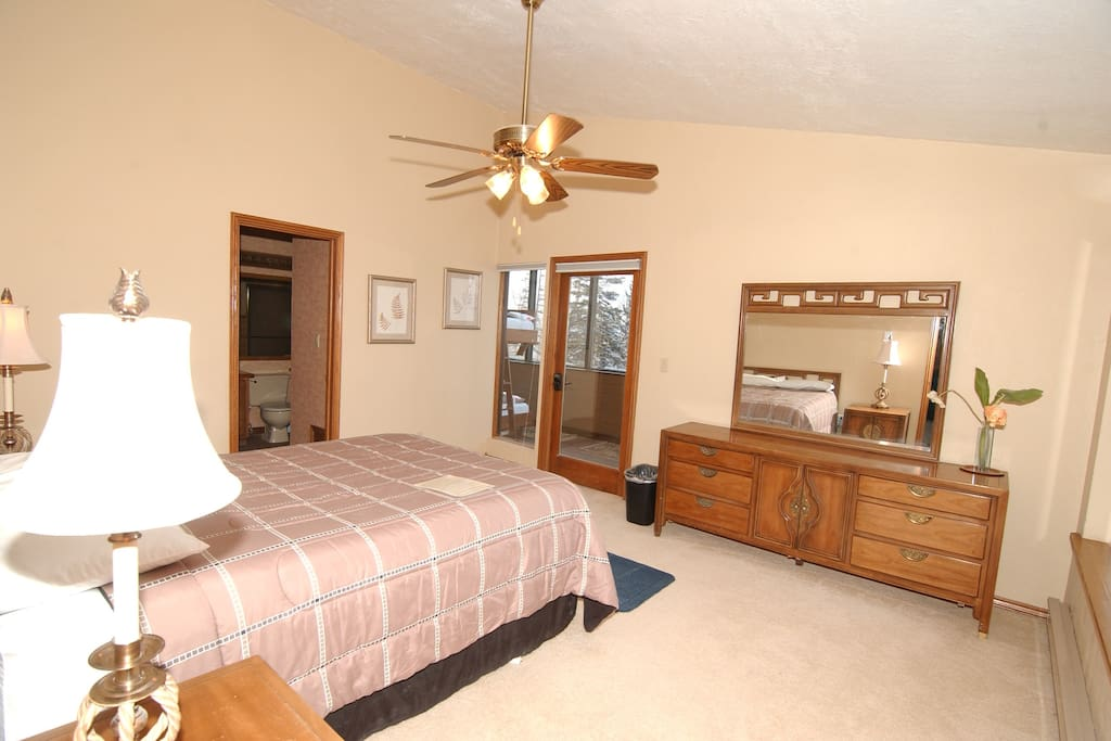 Master Bedroom w/ Queen Bed and attached sun room with single bed or single over single bunk bed.  Window has views of forest.