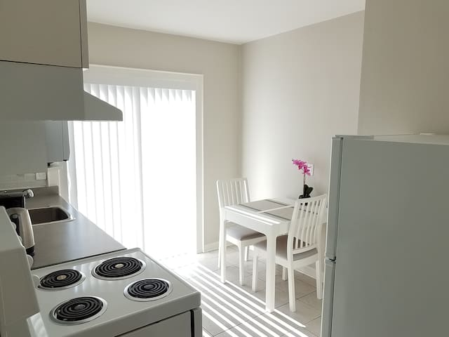 The kitchen offers eat-in functionality.  Sunrise floods the kitchen through sliding doors. These allow access to a large deck.   The table extends to accommodate four persons.