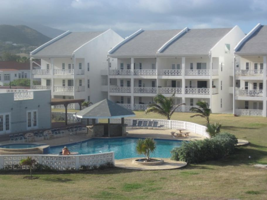 The large communal swimming pool and Jacuzzi, with is set between the communal tennis court and the beach.