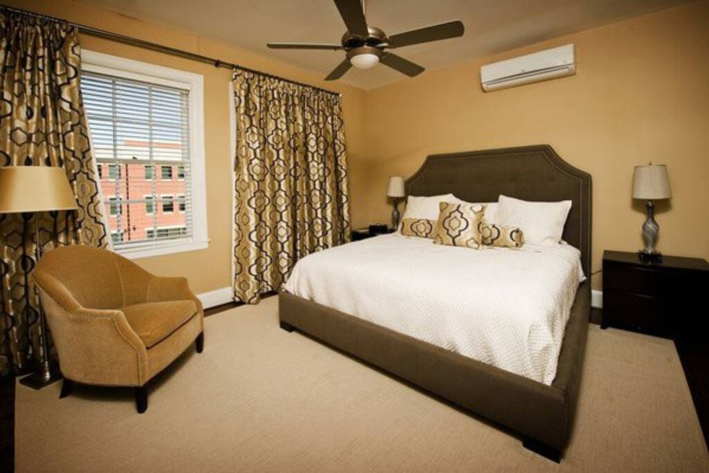 king size bed and 2 walk-in closets in the bedroom