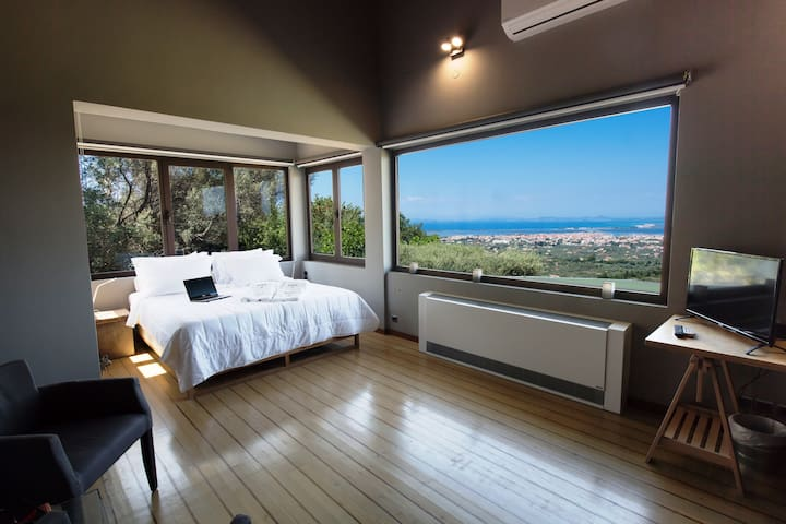 Master bedroom with king-size bed with reclining back
