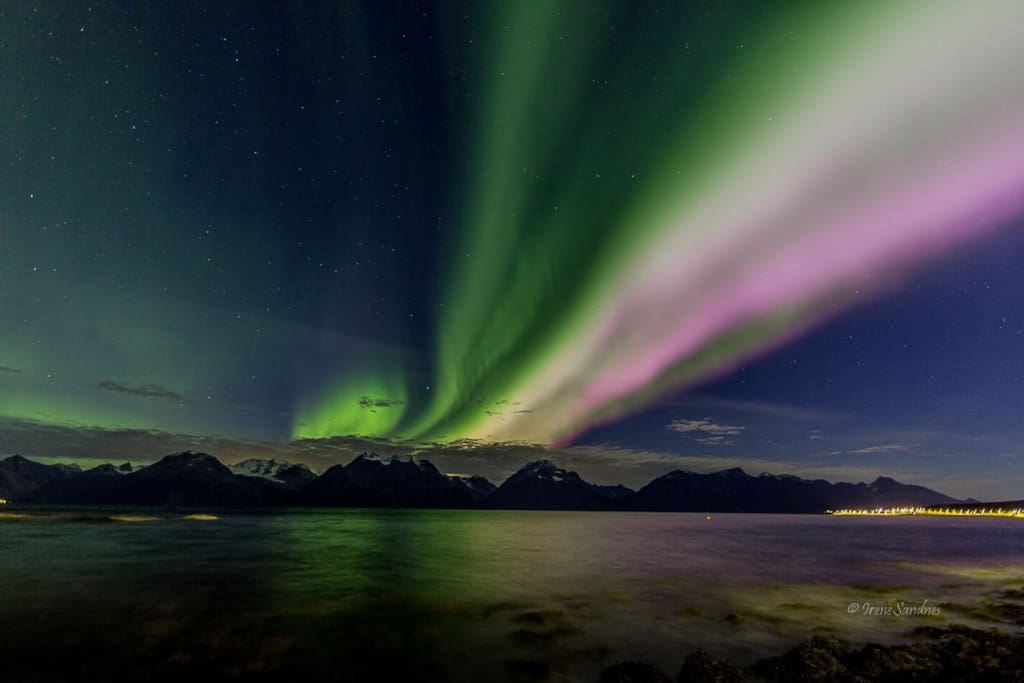 Northern lights above the Lyngen Alps, seen from the boat house belonging to the property. October 2016.