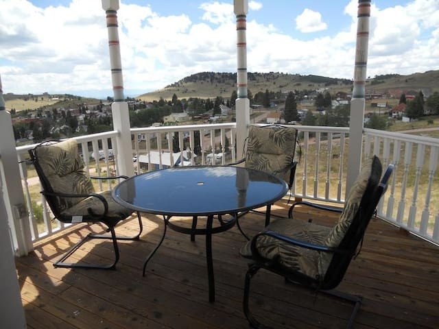 Stunning views of Cripple Creek and theSangre de Cristo Mountains from our wrap-around deck with gazebo
