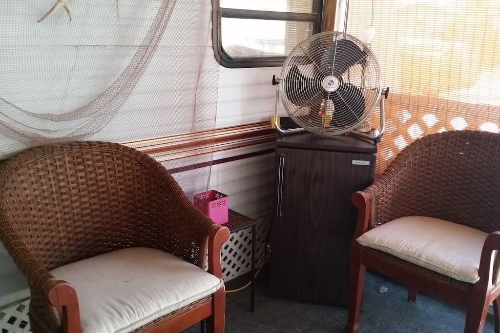 Seating area with mini fridge on screened-in porch